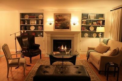 sweet built-ins. and I like the sconces on the fire place