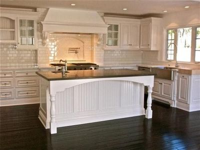white kitchen dark tile floors white kitchen cabinets tile