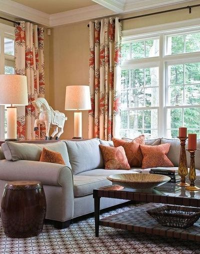 Cream living room with blue gray rich brown and rust red for Rich colors for living room