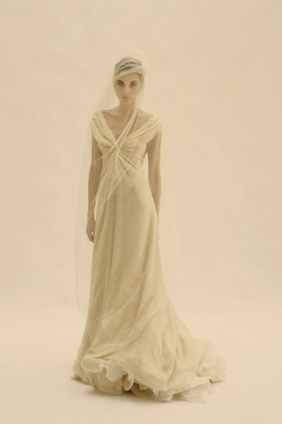 This cortana gown in white worn more fitted through t for Pre worn wedding dresses