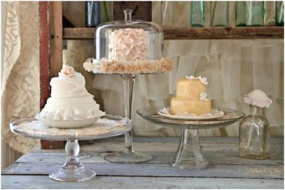pretty mini cakes on vintage glass cake stands, sweets displ ...
