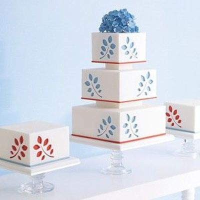 White Blue And Red Wedding Cake With Cut Out Floral Detail
