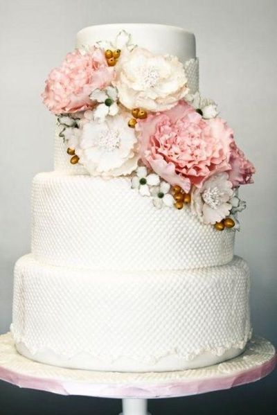 wedding cake with textured fondant and gumpaste peonies and other flowers