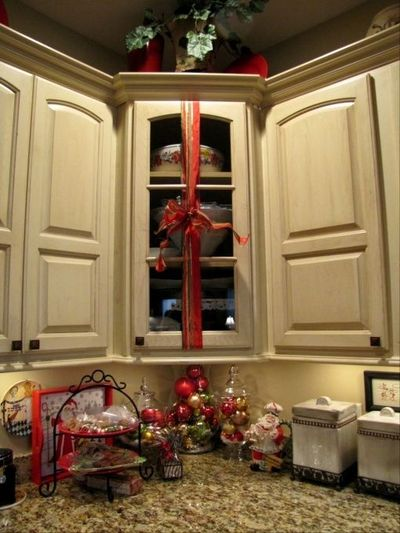 wrap ribbon with a bow around kitchen cabinets christmas