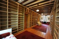 IKEA bookcases... floor to ceiling library. I'd love it!! Books and CD storage!