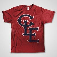 CLE - TRIBE Overlapping C-L-E letter design in Cleveland Indians' baseball colors. 2-Colors on a red unisex fashion fit, soft ringspun cotton t-shirt.