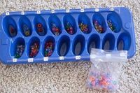 Ice cube tray, pony beads....label each spot w/ a number and children practice one to one correspondence.
