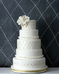 5 tier white wedding cake with gold accents