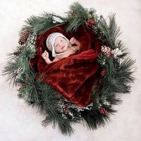 Baby in a wreath.