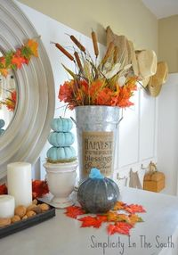 Thanksgiving display and a free fall printable banner. I like the colors- natural with leaf colors and pops of aqua.