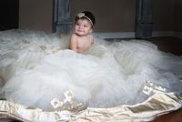 6 month baby photo on mommy's wedding dress.