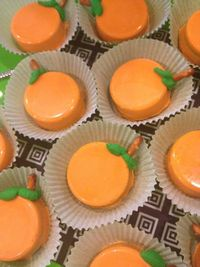 Chocolate Covered Oreos~White Chocolate dyed Orange and then Pipe some leaves on with Green Frosting and add a Pretzel for a Stem!