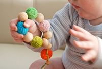 NihaMaj - The colorful toy from 11 wooden beads and organic cotton.