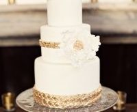 Ivory, Mustard, and Gold Spanish Inspired Fondant Wedding Cake with intricate braiding detail