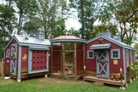 Carpenter's new coop is a chicken paradise. The exterior nesting boxes have viewing windows and can be accessed from the outside, which makes collecting eggs a bit easier. The coop also has a solar light and a solar fan inside. The fan kicks in at a c...