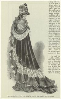 An evening wrap of black satin trimmed with lace. (1900)
