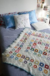 granny square afghan with white motifs
