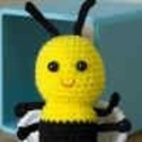 With a small amount of yellow, black and white yarn, you can create an adorable amigurumi baby bee. Give as a gift, use to decorate a child's room, or let this cheerful bee keep you company at your desk.