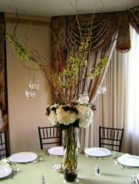 Inspiration pix for curly willow branch centerpieces beautiful with the hanging candles, and will light up the room at night!
