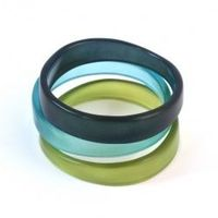These resin bangle replicate the smooth form and texture of their clay models, but are light and durable, with fresh spring colours.