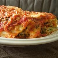 This rich meat, spinach and cheese filled manicotti dish is covered with white and red sauces. It takes some time to prepare, but is well worth the effort!