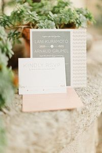 arrow invitations in a soft pink and grey palette Photography by xaviernavarro.com