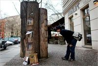"""Book Forest"" is an outdoor, public bookcase in Berlin, designed to allow BookCrossing users to drop books they're done with so that others can take them in and read them. The ""forest"" is made from hollowed out logs with protective cle..."