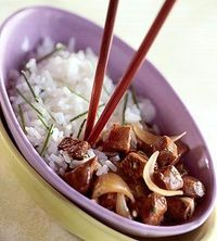 Roasted garlic added to plain rice makes it the perfect go-along with the beef roast in this one-dish dinner recipe.