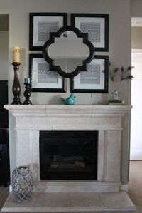 Black spray painted frames above the fireplace hold scrapbook paper. For a 3-D effect, install the mirror with L brackets.