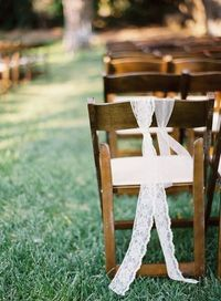 lace used to decorate the aisle chairs. how simple? and so pretty! Photography by http://kurtboomerphoto.com, Wedding Design and Planning by http://joydevivre.net