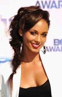 Alicia Keys | Side, twisted, messy fishtail braid for curly hairstyle