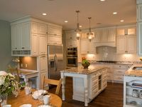 Love the set up for this kitchen but I would definitely change the colors...