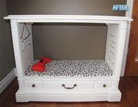 An old console style TV repurposed as a doggie bed.