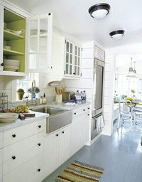 white kitchen with green inside the cabinets
